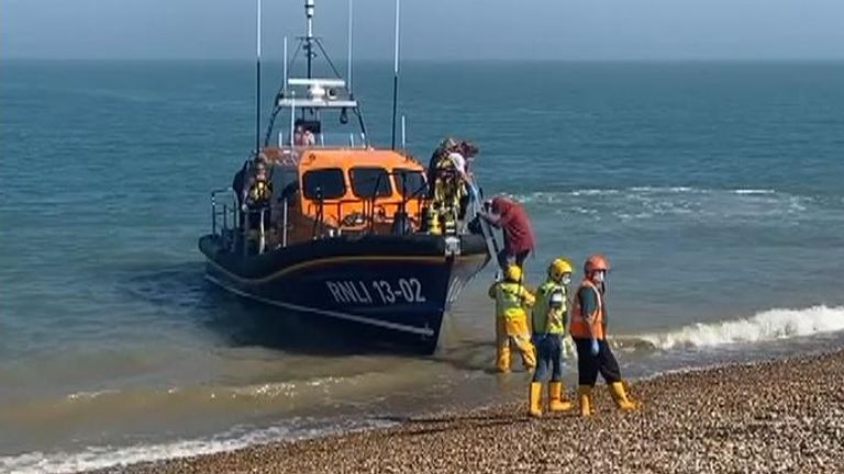Migrants arrive on the beach at Dungeness