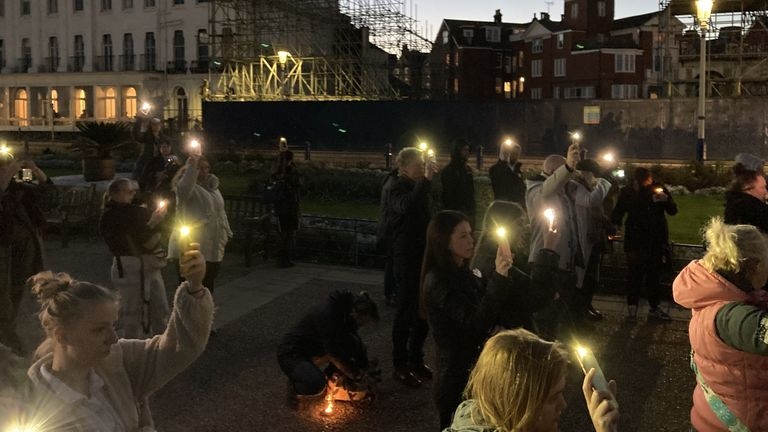 Protesters light up their mobile phones
