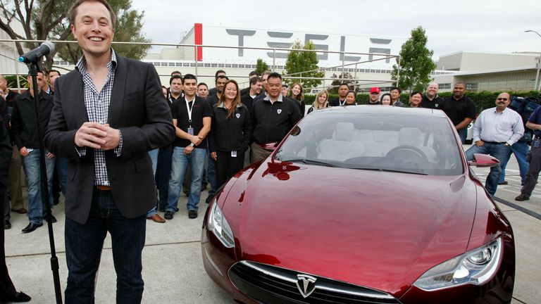 Elon Musk with a Tesla Model S. Pic: AP