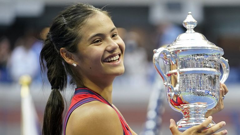 File photo dated 11-09-2021 of Great Britain's Emma Raducanu holds the trophy as she celebrates winning the women's singles final on day twelve of the US Open at the USTA Billie Jean King National Tennis Center, Flushing Meadows- Corona Park, New York. Issue date: Monday October 4, 2021.