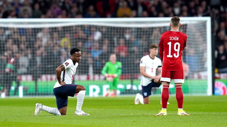 England's Raheem Sterling (left) takes a knee