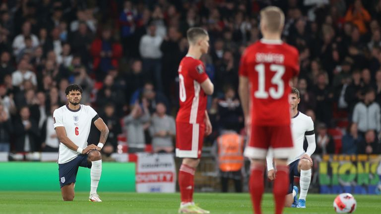 England players knelt before kick-off on Tuesday night, while Hungary's players remained standing