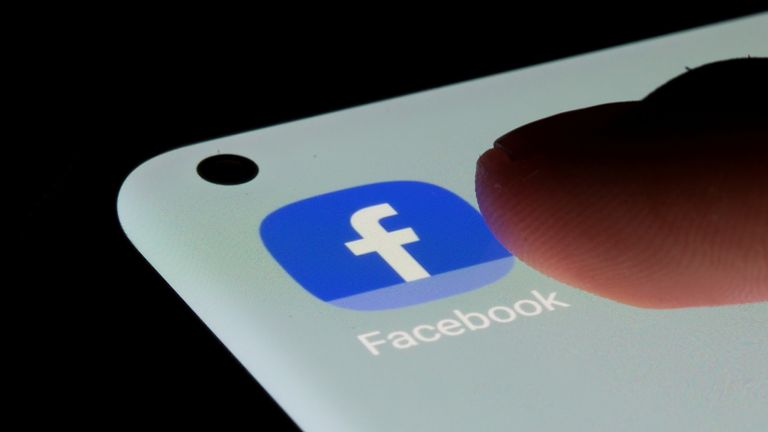 The Facebook app is seen on a smartphone