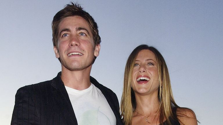 """Jennifer Aniston (R) and Jake Gyllenhaal, cast members in the motion picture dark comedy """"The Good Girl"""" pose during an industry screening of the film at the Pacific Design Center in the West Hollywood section of Los Angeles August 7, 2002. """"The Good Girl"""" opens in Los Angeels and New York on August 7. REUTERS/Jim Ruymen JR"""