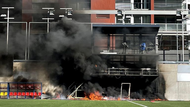 A fire breaks out at Estadi Nacional, Andorra. Preparations for England's World Cup qualifier in Andorra were hit by a fire at the Estadi Nacional. The television gantry at the side of the 3,300-seater stadium was engulfed in flames on Friday afternoon, three hours after England had trained there. Picture date: Friday October 8, 2021.