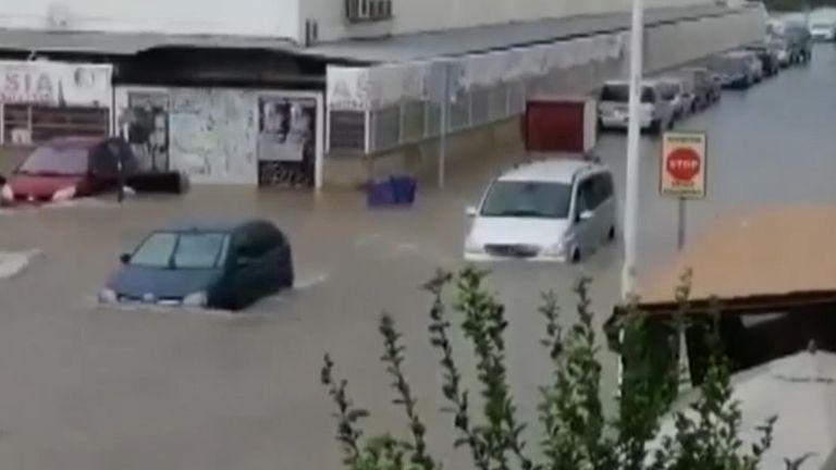 Heavy rains wash away chairs, flood cars in Spain