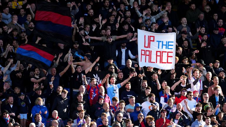 Crystal Palace fans cheer on their team during the Premier League match at Selhurst Park, London. Picture date: Sunday October 3, 2021.