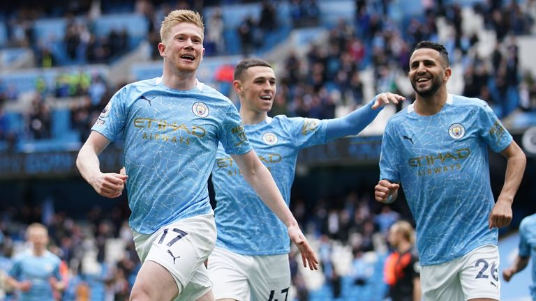Soccer Football - Premier League - Manchester City v Everton - Etihad Stadium, Manchester, Britain - May 23, 2021 Manchester City's Kevin De Bruyne celebrates scoring their first goal with Riyad Mahrez and Phil Foden Pool via REUTERS/Dave Thompson