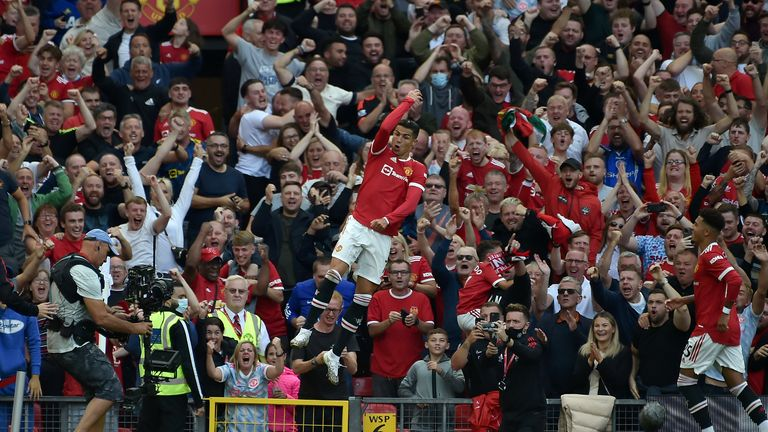 Manchester United's Cristiano Ronaldo celebrates after scoring his side's second goal during the English Premier League soccer match between Manchester United and Newcastle United at Old Trafford stadium in Manchester, England, Saturday, Sept. 11, 2021. (AP Photo/Rui Vieira) PIC:AP