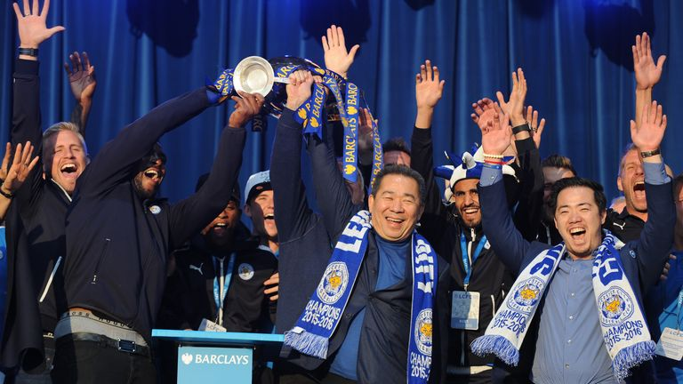 Leicester City Vice Chairman Aiyawatt Srivaddhanaprabha, right, and Chairman Vichai Srivaddhanaprabha, 2nd right, show the Premier League Trophy to fans at Victoria Park during the victory parade to celebrate winning the English Premier league title in Leicester, England, Monday, May 16, 2016. (AP Photo/Rui Vieira). PIC:AP