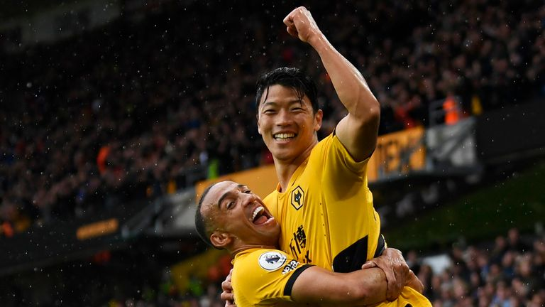 Premier League - Wolverhampton Wanderers v Newcastle United Soccer Football - Premier League - Wolverhampton Wanderers v Newcastle United - Molineux Stadium, Wolverhampton, Britain - October 2, 2021 Wolverhampton Wanderers' Hwang Hee-Chan celebrates scoring their second goal with Marcal REUTERS/Tony Obrien