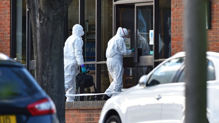 Forensics experts at the scene