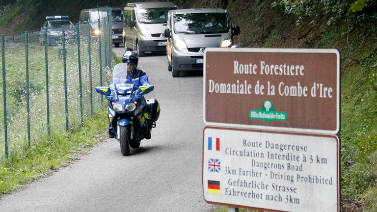 French gendarmes escort hearses leaving La Combe d'Ire raoad in Chevaline near Annecy, southeastern France, September 6, 2012. French police have found a girl of about four years old alive inside a British-registered BMW car where they discovered three people shot dead on Wednesday, September 5, a public prosecutor said. A fourth body, apparently a person who had been riding a bicycle, was found nearby. A badly injured eight-year-old girl, also found nearby, was taken to hospital by helicopter.