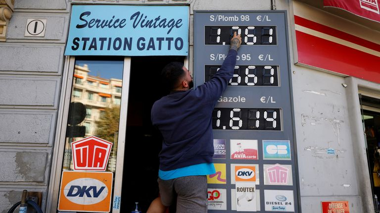 An employee updates fuel price signs at a petrol station in Nice, France, October 13, 2021. REUTERS/Eric Gaillard
