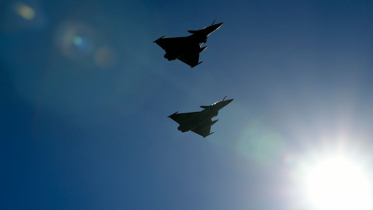 Two French Rafale fighter jets perform a flyover during a joint military drill