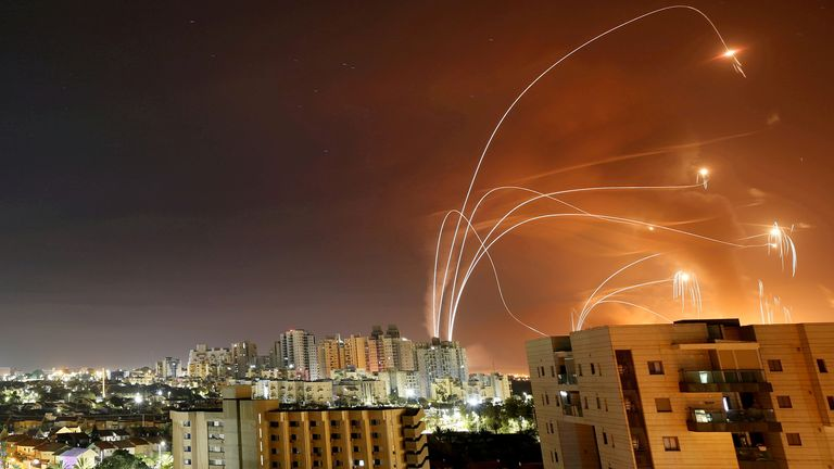 FILE PHOTO: Streaks of light are seen as Israel's Iron Dome anti-missile system intercepts rockets launched from the Gaza Strip towards Israel, as seen from Ashkelon, Israel, May 12.   REUTERS/Amir Cohen//File Photo