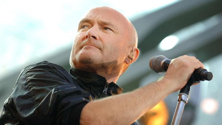 It's not clear which member or members of the band have tested positive. Pictured: Phil Collins