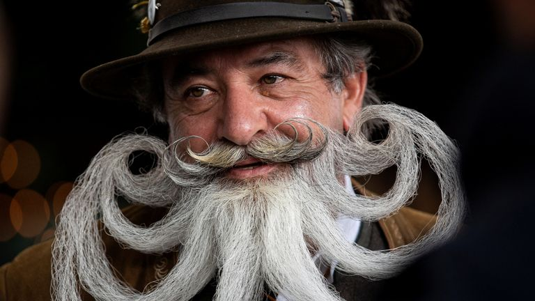 Participant Norbert Dopf from Austria arrives for the German Moustache and Beard Championships 2021 at Pullman City Western Theme Park in Eging am See, Germany, October 23, 2021. REUTERS/Lukas Barth