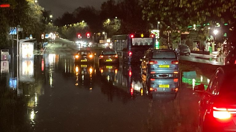 Cars driving along roads submerged in water in Glasgow. Pic: Prof Larissa Naylor
