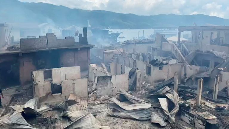 Burned houses are pictured after a fire at a residential area on the island of Guanaja, Honduras