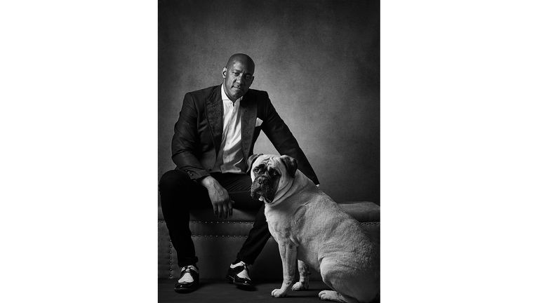 ONE USE ONLYDion Dublin with Bullmastiff Maggie Celebrity portrait photographer Andy Gotts has created a series of stunning images of the UK's most famous faces - and their dogs. Must Credit: Andy Gotts / Guide Dogs