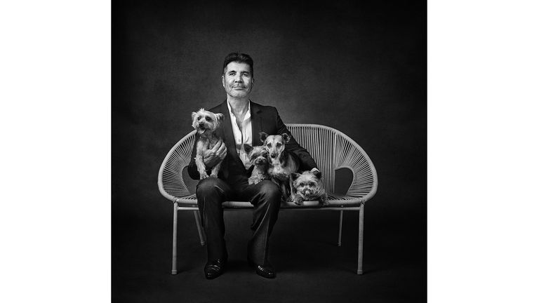 ONE USE ONLY Simon Cowell with Squiddly, Diddly, Freddy and Daisy Celebrity portrait photographer Andy Gotts has created a series of stunning images of the UK's most famous faces - and their dogs. Must Credit: Andy Gotts / Guide Dogs