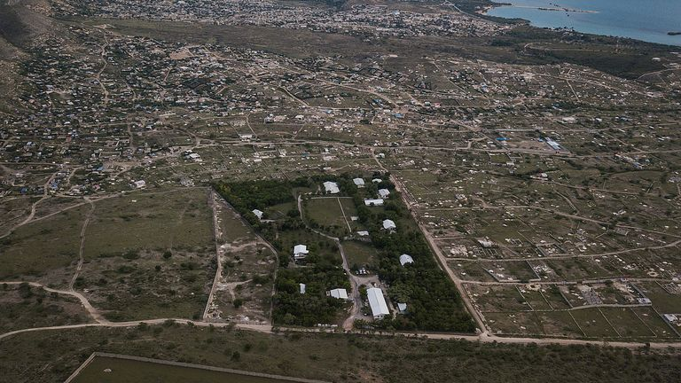 An aerial view of Christian Aid Ministries headquarters in Titanyen, Haiti, Thursday, Oct. 21, 2021. The leader of the 400 Mawozo gang that police say is holding 17 members of missionary group is seen in a video released Thursday saying he will kill them if he doesn't get what he's demanding. (AP Photo/Matias Delacroix)
