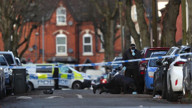 Police officers searching the scene in Linwood Road, Handsworth on 22 January