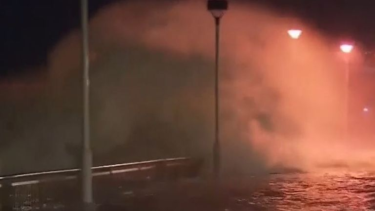 Waves crash over sea wall in Hong Kong as typhoon approaches