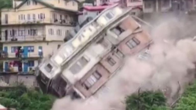 Multi-storey building collapses down hillside in India