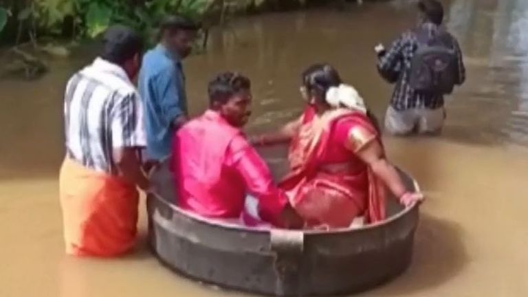 Bride and groom float to wedding in cooking pot