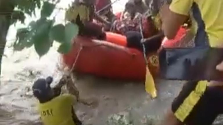 Around 25 people were rescued from an island in the Ganges by teams pulling an inflatable craft, after heavy rain caused huge floods in India's Uttarakhand state.