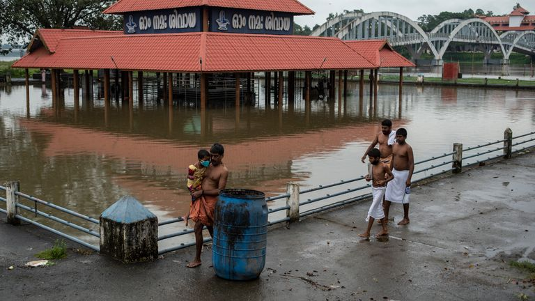 A Shiva temple on the banks of the Periyar River is surrounded by flood water following heavy rains in Kochi, Kerala. Pic: AP