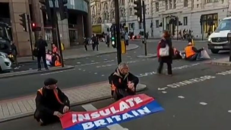 Protesters sit in the road in London