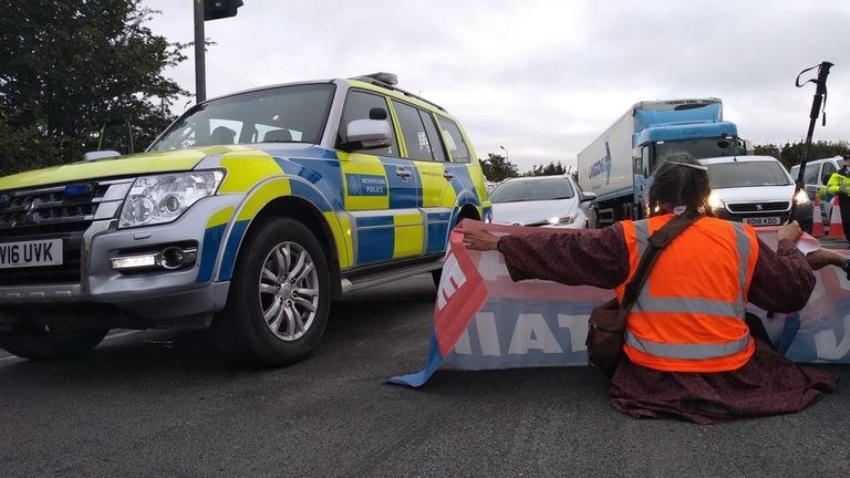 Handout photo issued by Insulate Britain of protesters from Insulate Britain blocking Junction 25 of the M25 motorway at Waltham Cross in Hertfordshire. Picture date: Friday October 8, 2021.