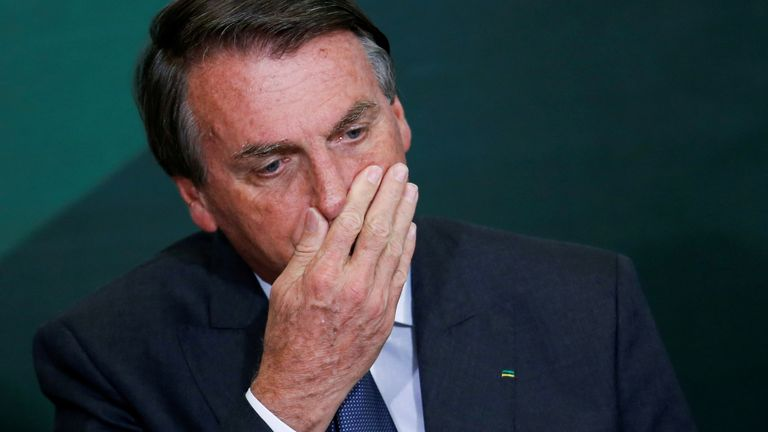 FILE PHOTO: Brazil's President Jair Bolsonaro reacts during the launching ceremony of the National Green Growth Program, at the Planalto Palace in Brasilia, Brazil October 25, 2021. REUTERS/Adriano Machado/File Photo