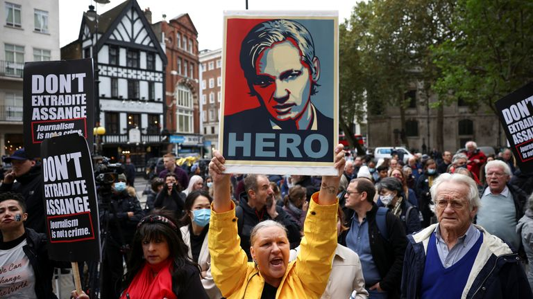 Supporters of Wikileaks founder Julian Assange protest outside the Royal Courts of Justice in London, Britain, October 27, 2021. REUTERS/Henry Nicholls
