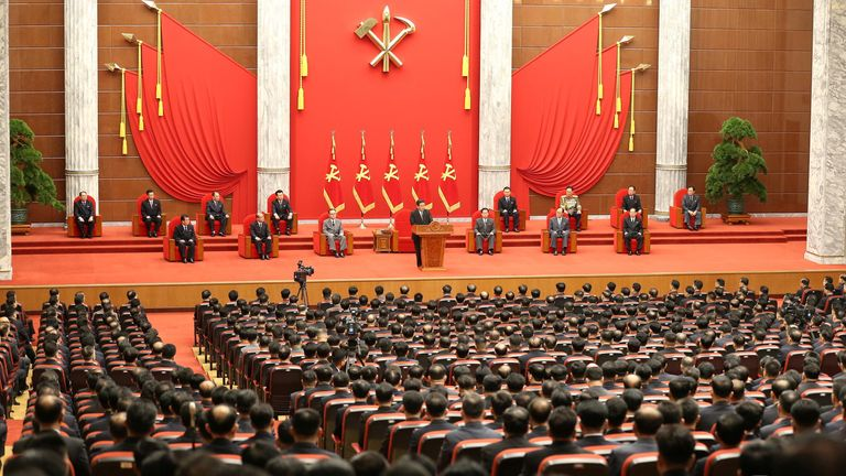 Kim addressed a room full of darkly dressed officials