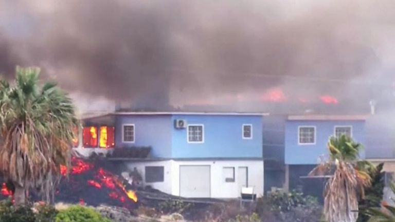 Houses burn as lava flows into them on La Palma