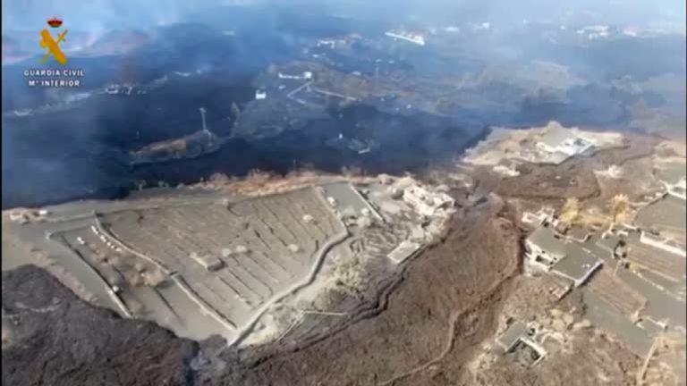 Drone footage shows black lava flowing from La Palma towards the ocean