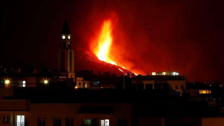 A church is seen against the eruption in El Paso, La Palma