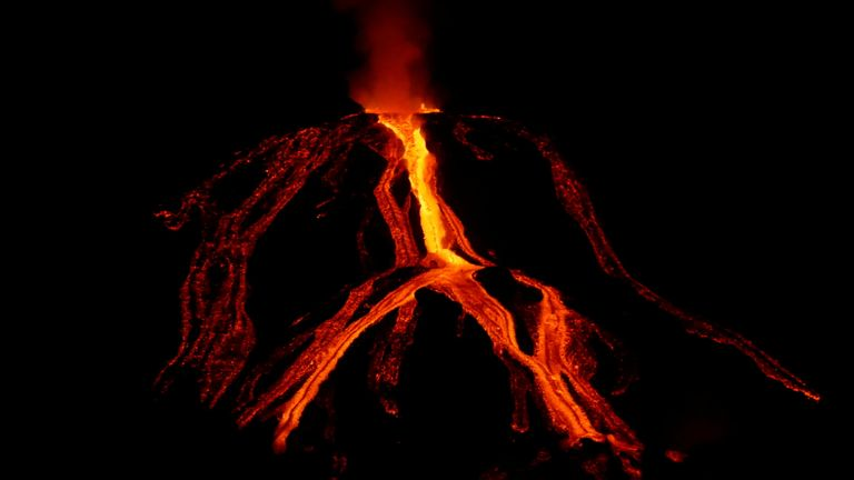 The Cumbre Vieja volcano spews lava as it continues to erupt on the Canary Island of La Palma
