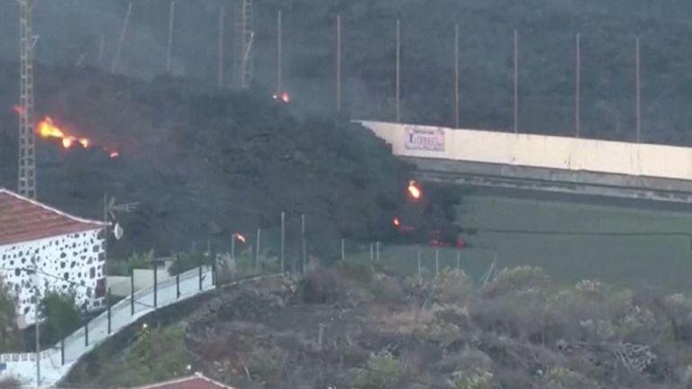 Lava from La Palma volcano moves across football pitch