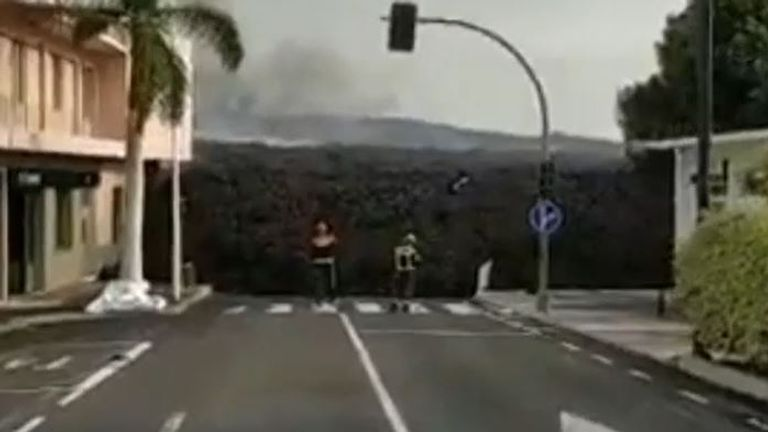Lava creeps along street in La Palma