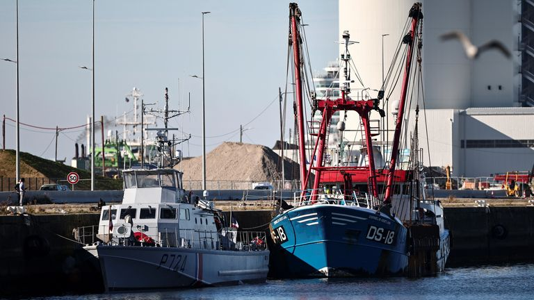 The French Gendarmerie patrol boat Athos and a British trawler Cornelis Gert Jan are seen moored in the port of Le Havre after France seized on Thursday a British trawler fishing in its territorial waters without a licence, in Le Havre, France, October 28, 2021. REUTERS/Sarah Meyssonnier