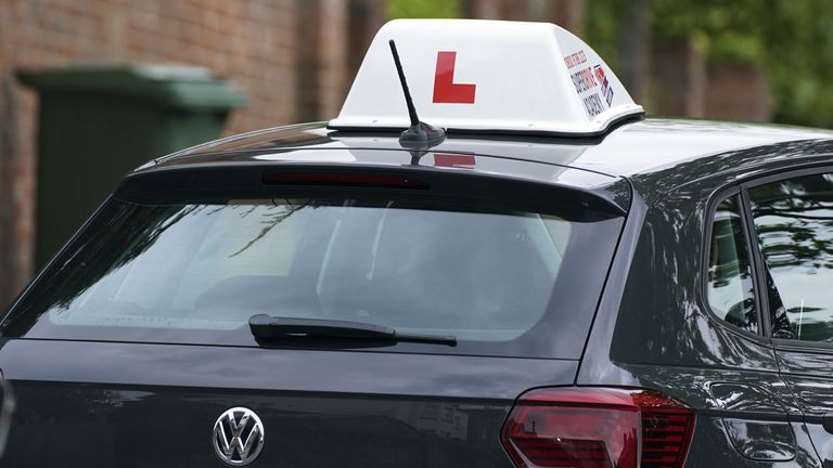 A learner driver drives down a street in Winchester, Hampshire. Picture date: Thursday May 20, 2021.