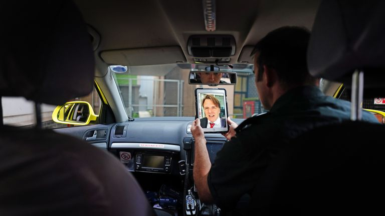 Paramedic Patrick Hunter uses an iPad to talk with consultant neurologist and stroke physician Dr Rob Simister