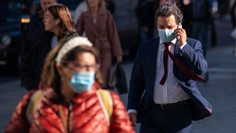 People wearing face masks on Oxford Street, in central London, as the Department of Health and Social Care is calling upon eligible people to get their covid-19 booster vaccinations. Picture date: Friday October 22, 2021.