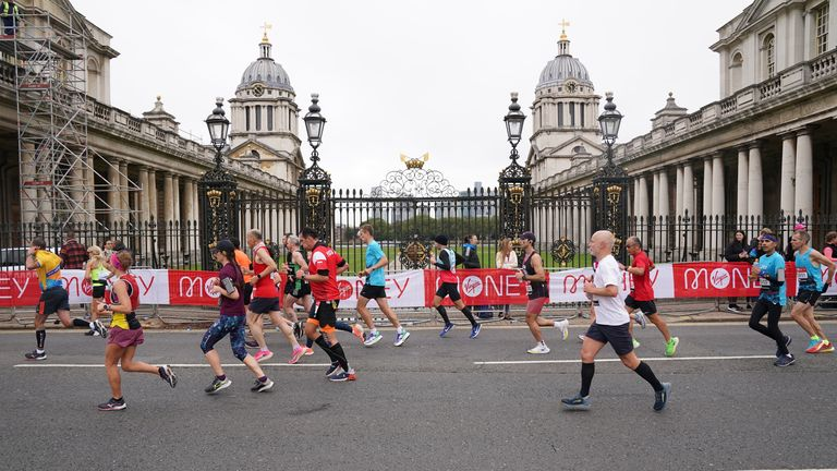 Runners pass the Old Naval College, Greenwich, during the Virgin Money London Marathon