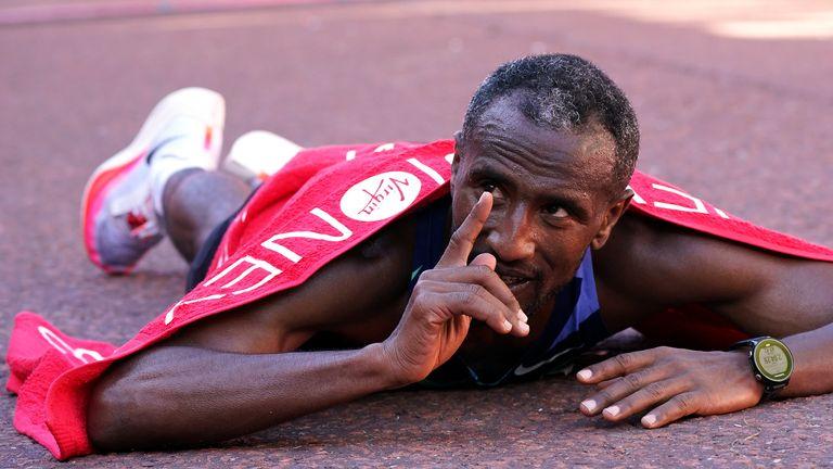 Sisay Lemma celebrates after winning the Men's elite race